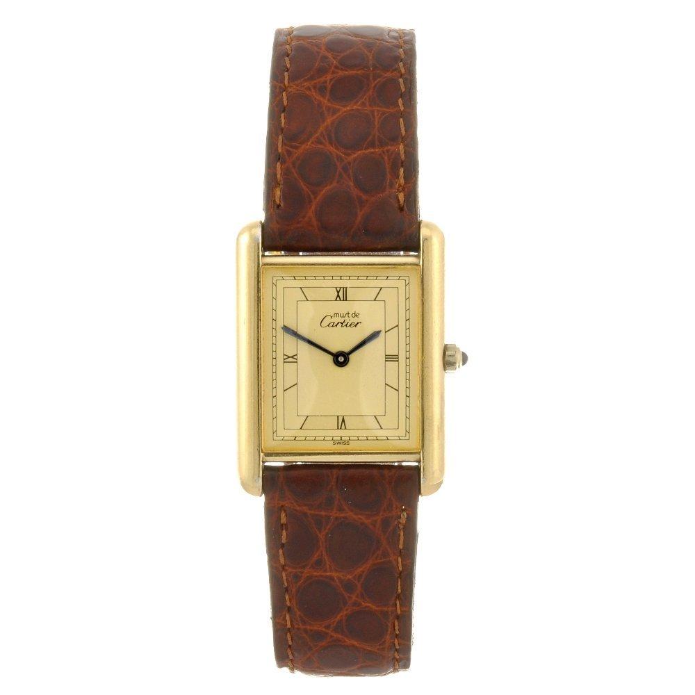 12: A gold plated quartz Must De Cartier wrist watch.