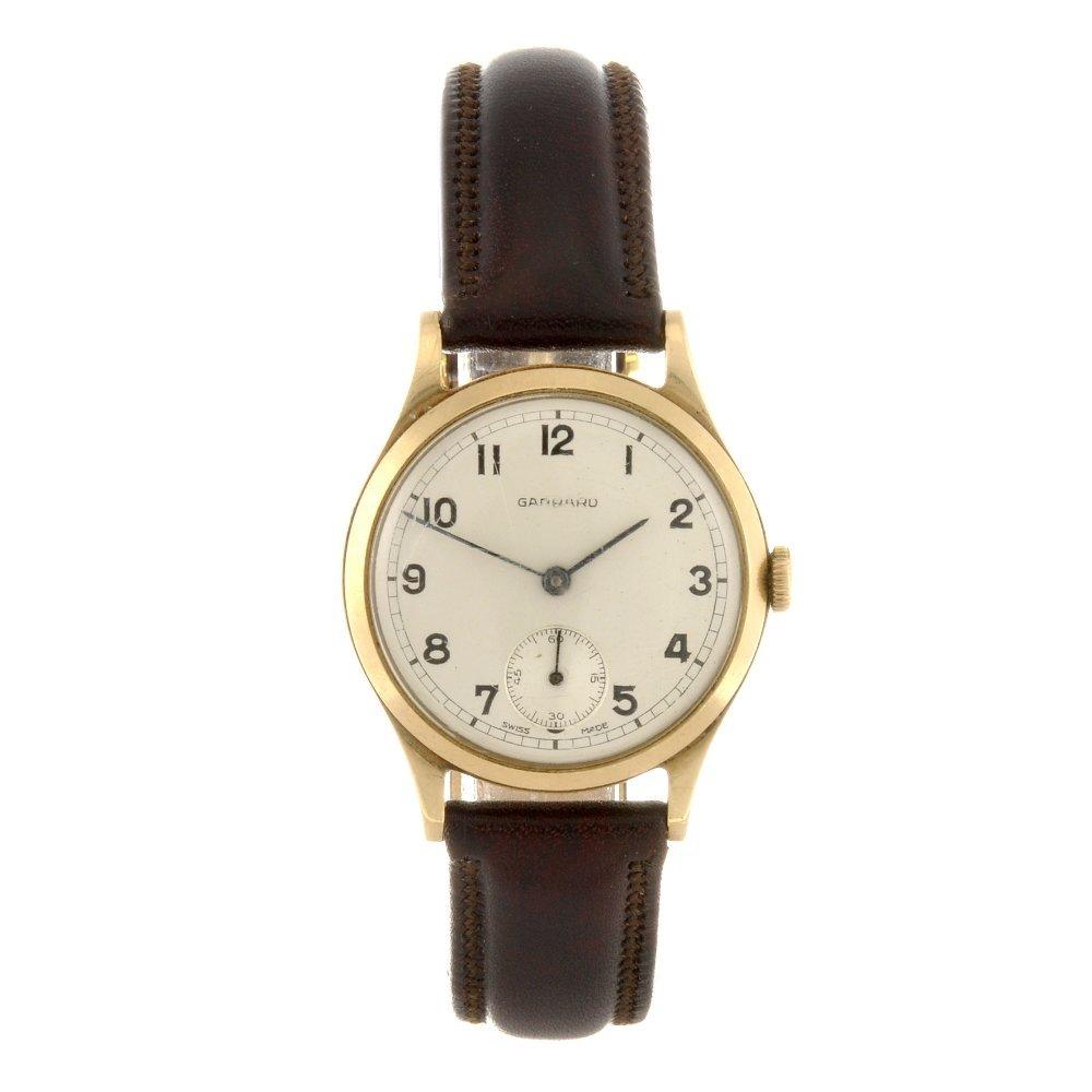 18: A 9ct gold manual wind gentleman's Garrard wrist wa