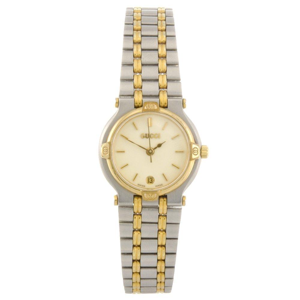 22: A bi-colour quartz lady's Gucci 9000L bracelet watc
