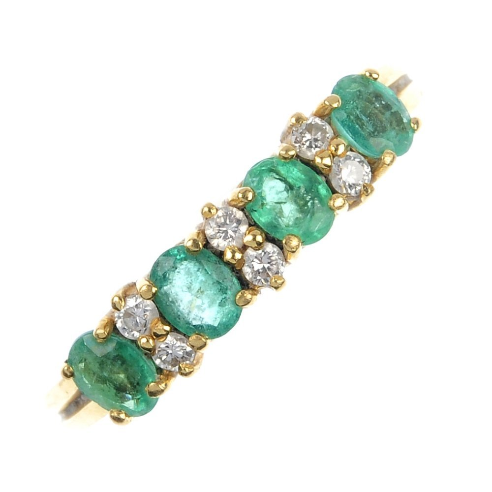 401: An 18ct gold emerald and diamond dress ring.