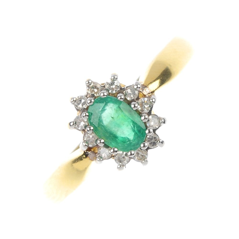 403: An 18ct gold emerald and diamond cluster ring.