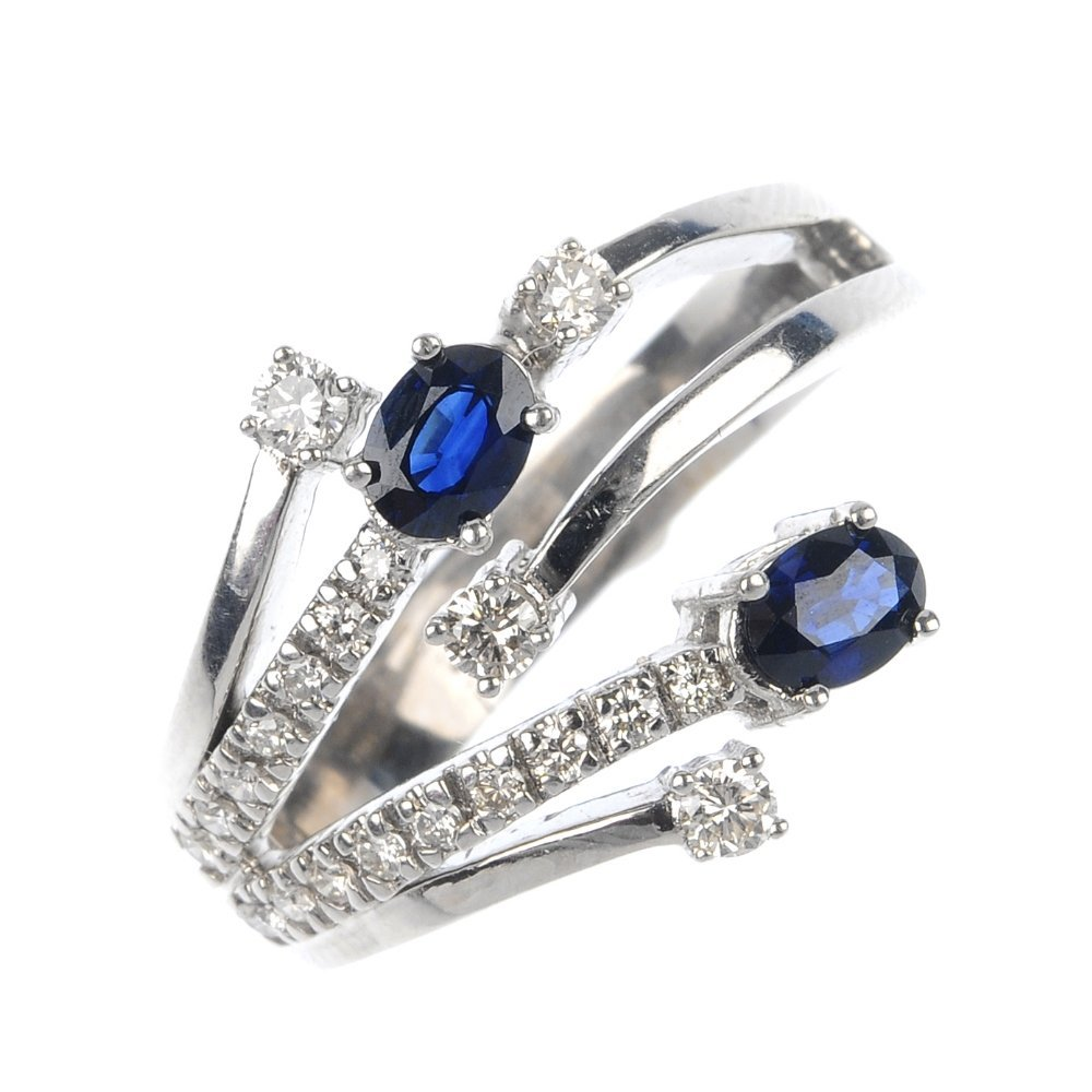404: An 18ct gold sapphire and diamond ring.