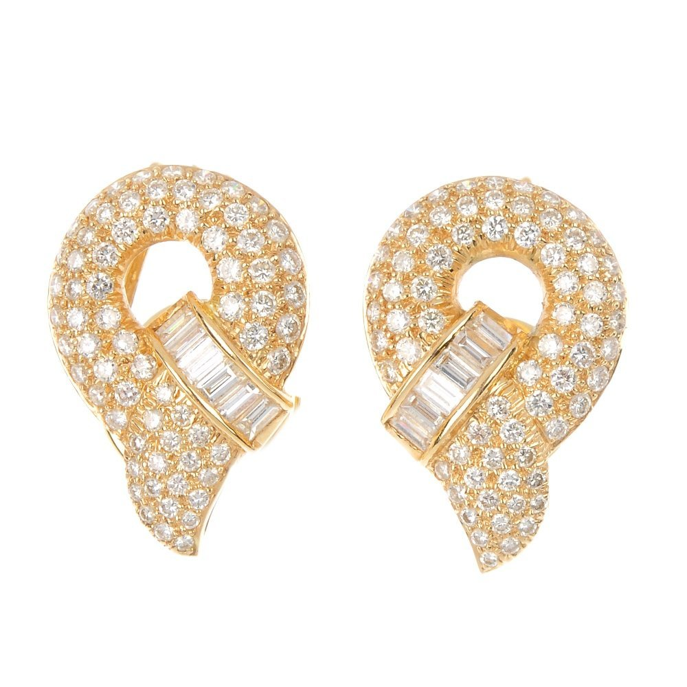 407: A pair of diamond earrings.