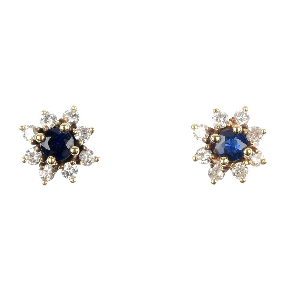 409: A pair of sapphire and diamond cluster ear studs.