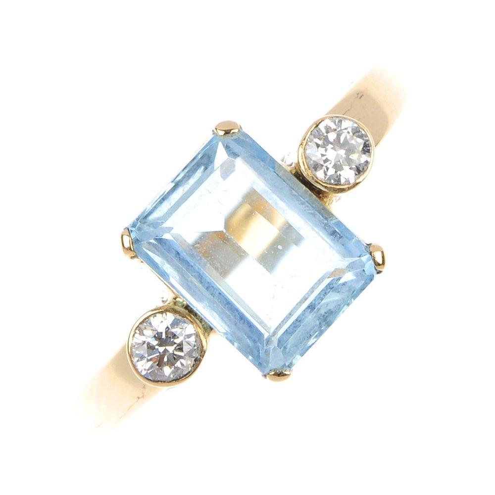 411: An aquamarine and diamond ring