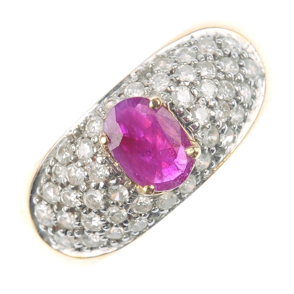 412: An 18ct gold ruby and diamond ring.