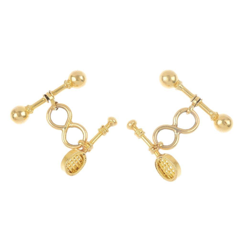 413: A pair of novelty cufflinks.