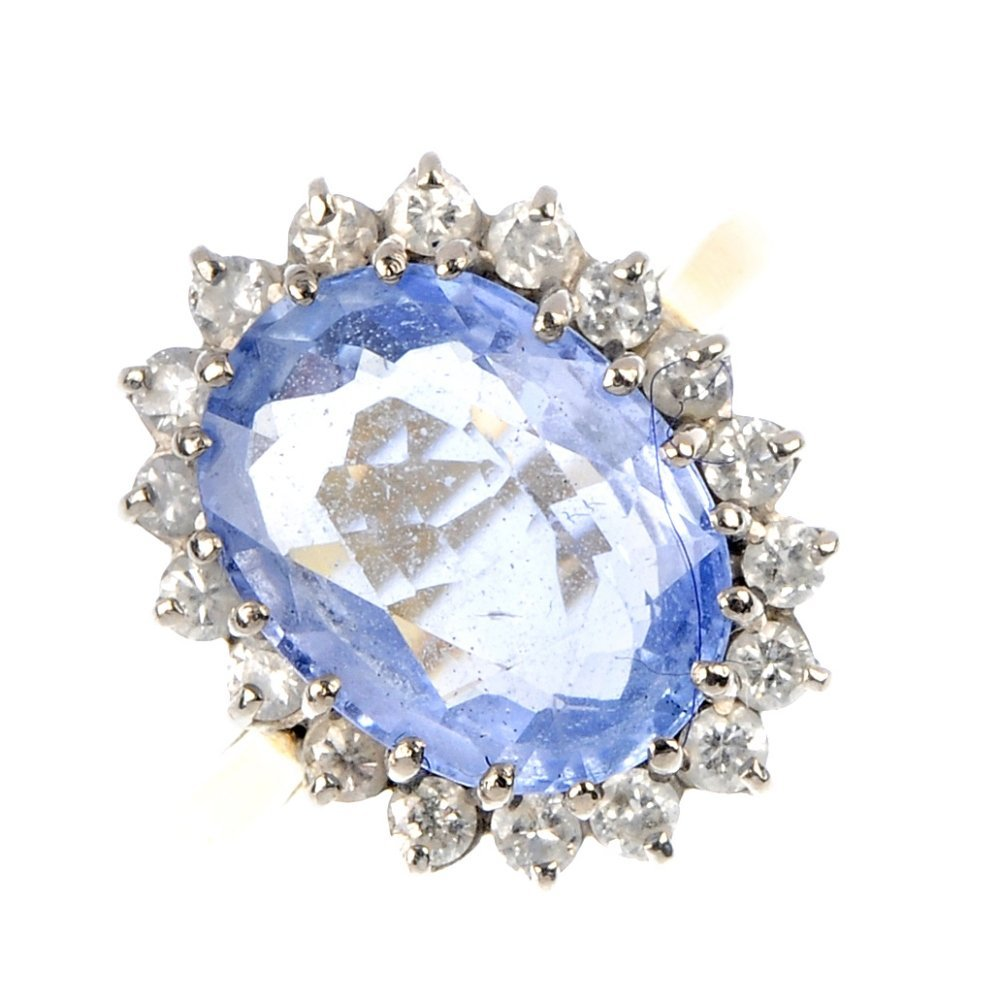 415: An 18ct gold sapphire and diamond cluster ring.