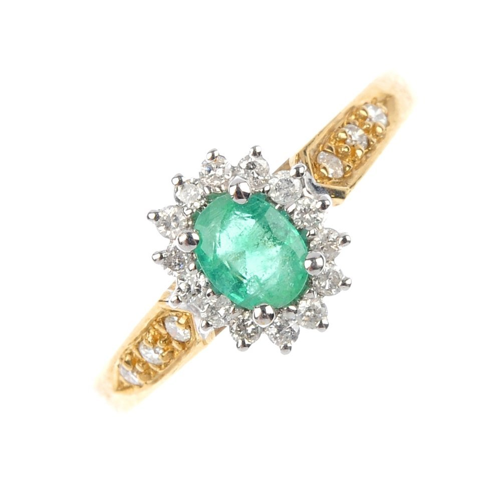 417: A 9ct gold emerald and diamond cluster ring.