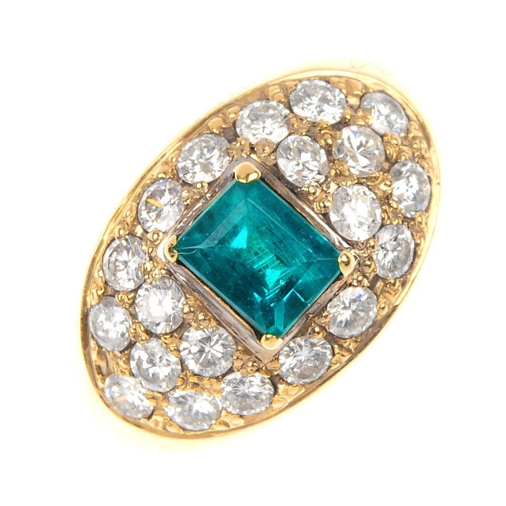 418: A synthetic emerald and diamond cluster ring.