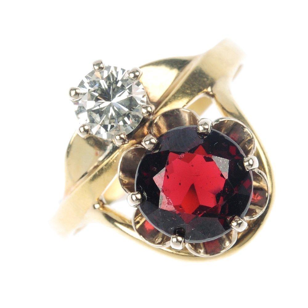 419: A garnet and diamond dress ring.