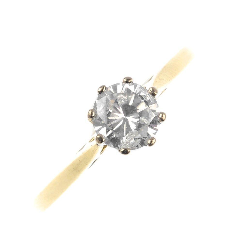 423: An 18ct gold diamond single-stone ring.