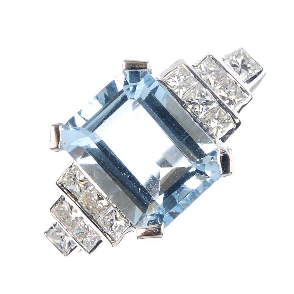 460: An aquamarine and diamond dress ring.