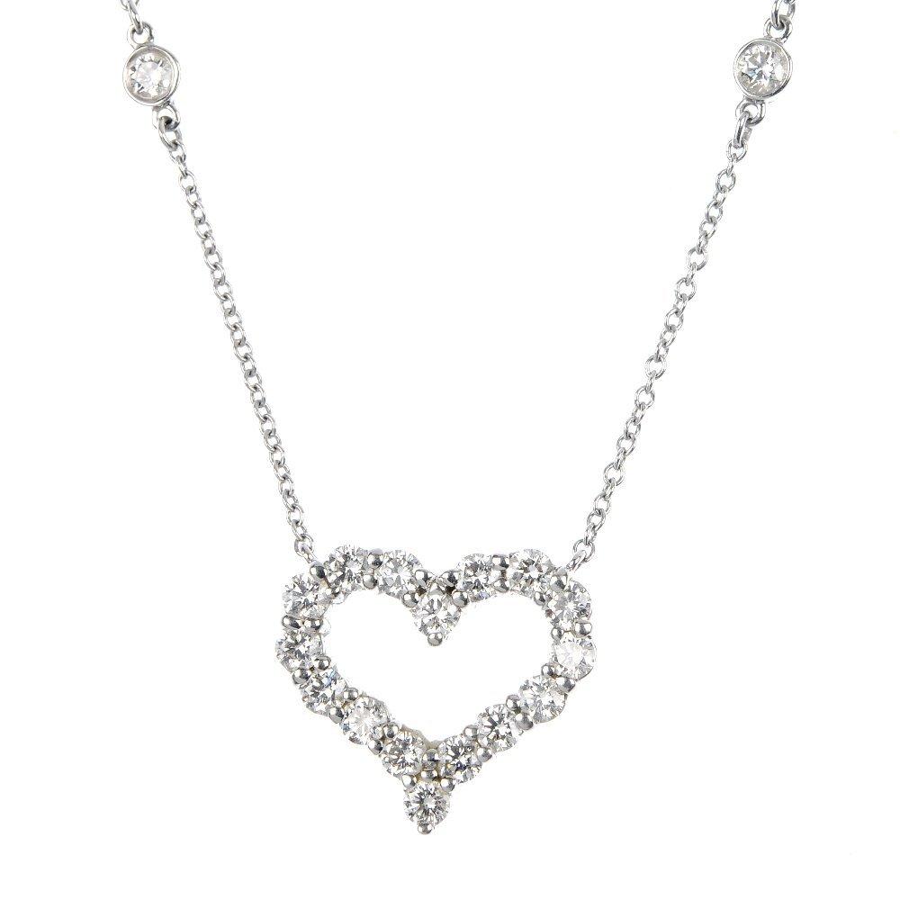 1010: (101231) TIFFANY & CO- a platinum diamond pendent