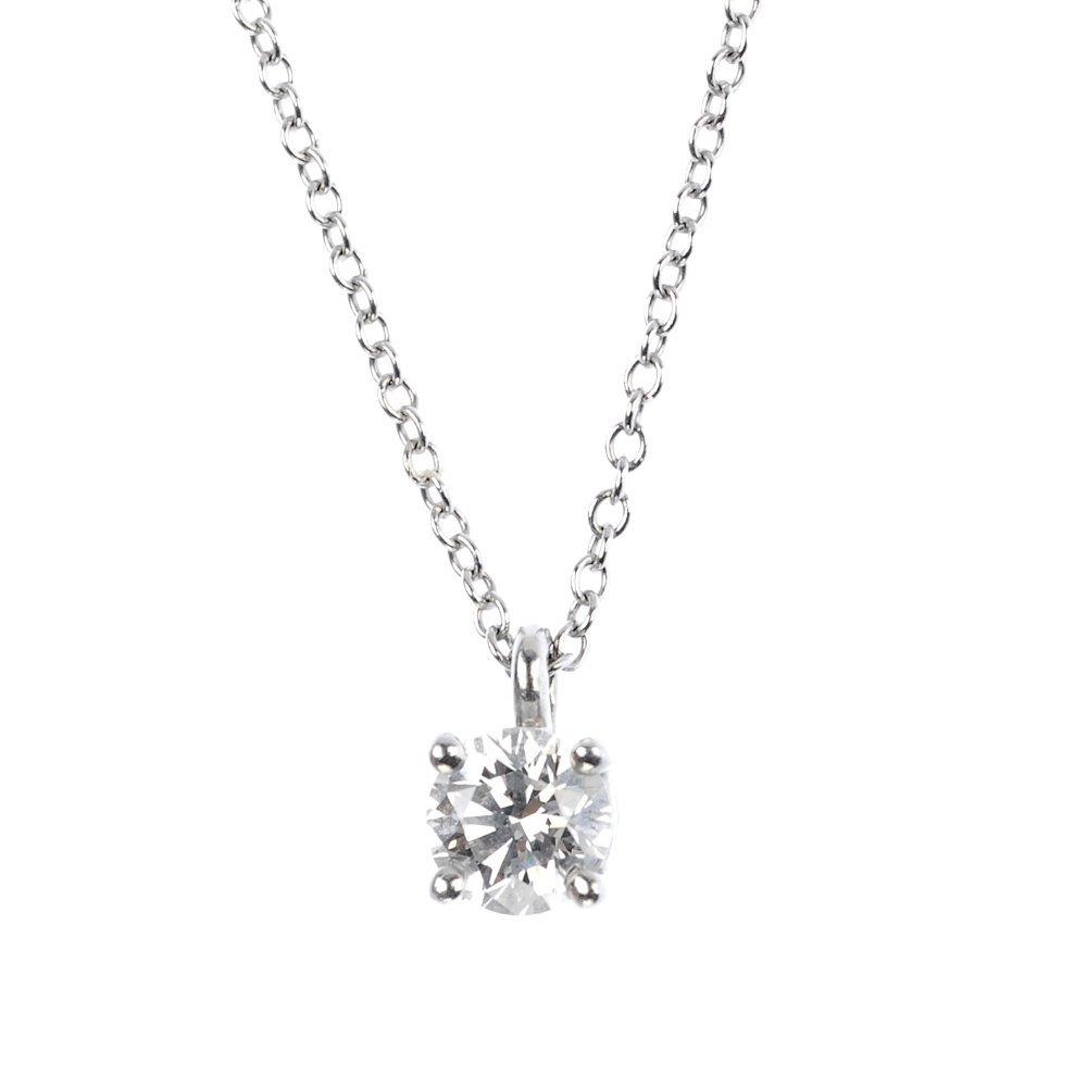 1038: (85140) TIFFANY & CO- a platinum diamond pendant.
