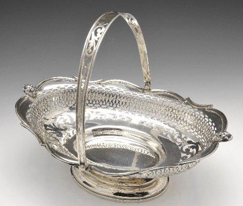 Edwardian silver swing handled basket.