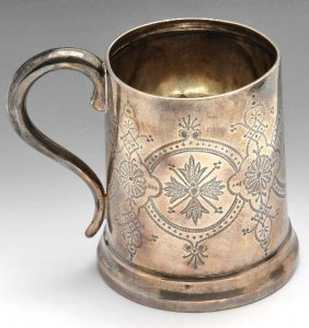 A late Victorian cased silver christening mug.