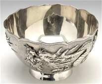 A Chinese white metal bowl.
