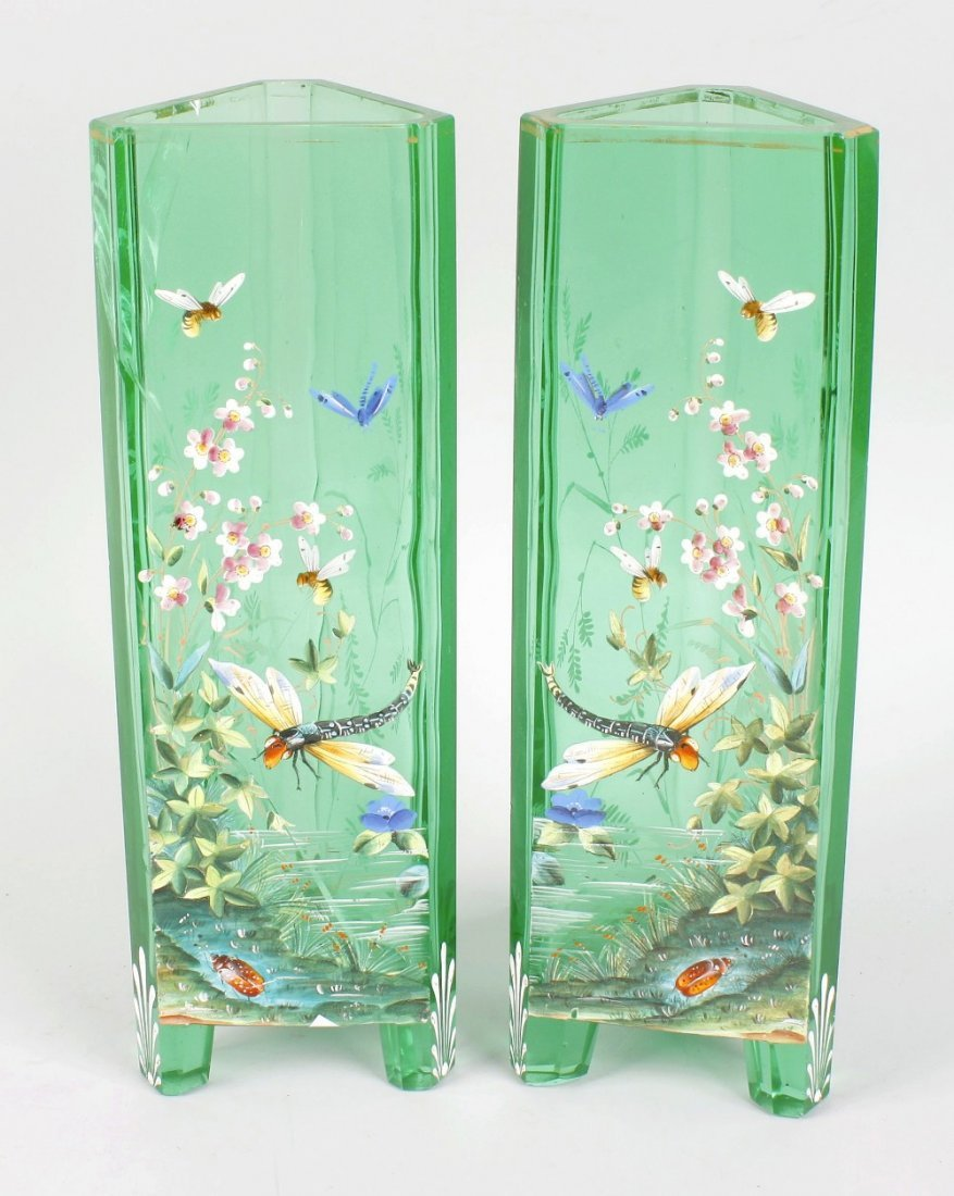 A good pair of enamelled emerald green glass vases
