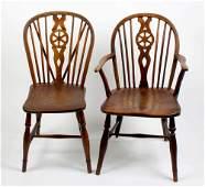 Four various wheel back windsor armchairs