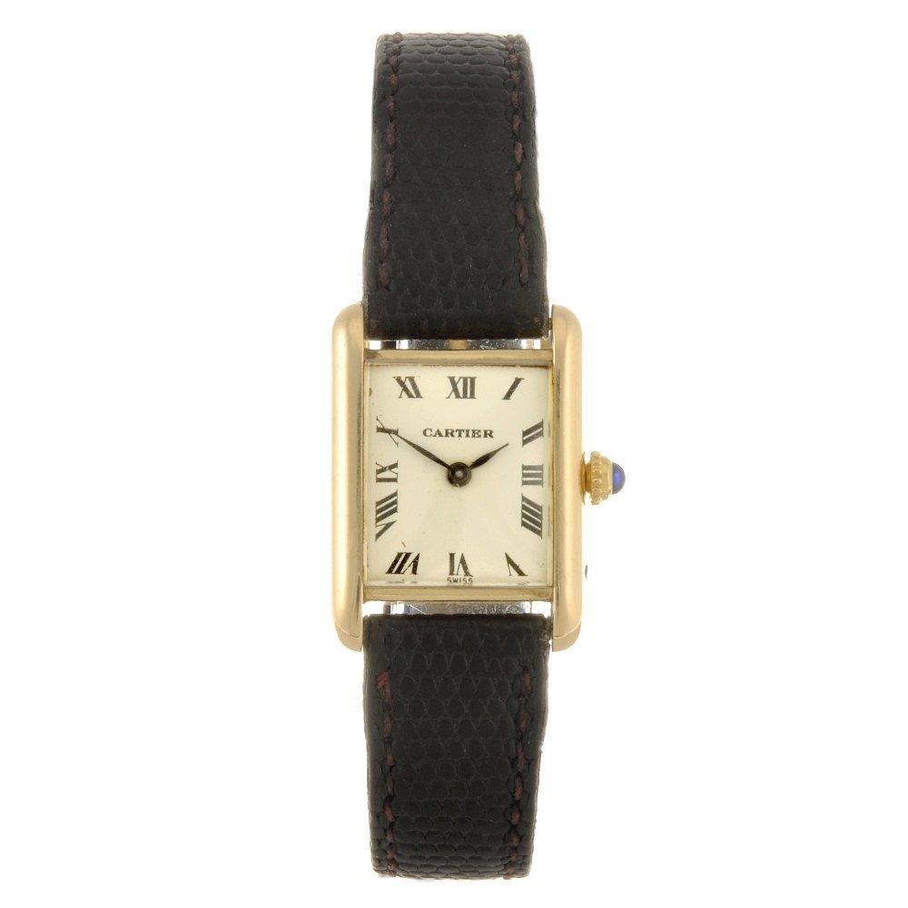 13: An 18k gold Cartier Tank wrist watch.