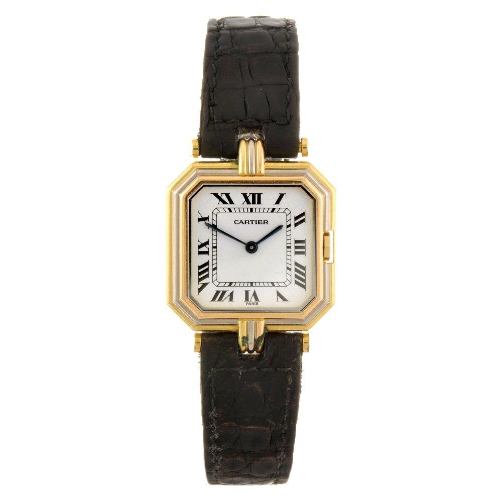 18: An 18k gold quartz Cartier Ceinture wrist watch.