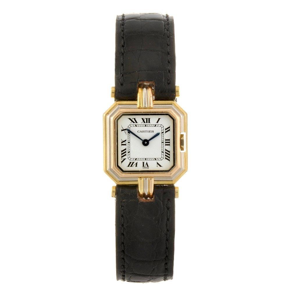 19: An 18k gold quartz Cartier Ceinture wrist watch.