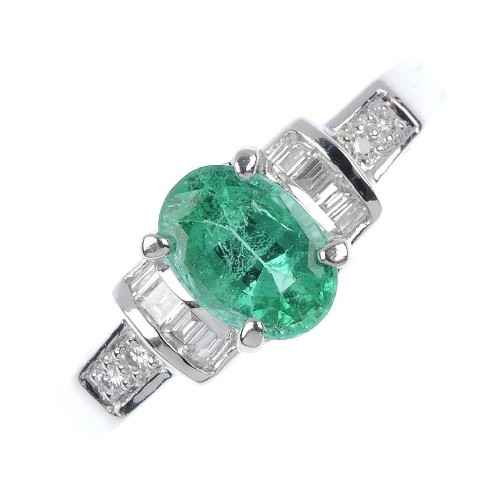 1: An emerald and diamond dress ring.