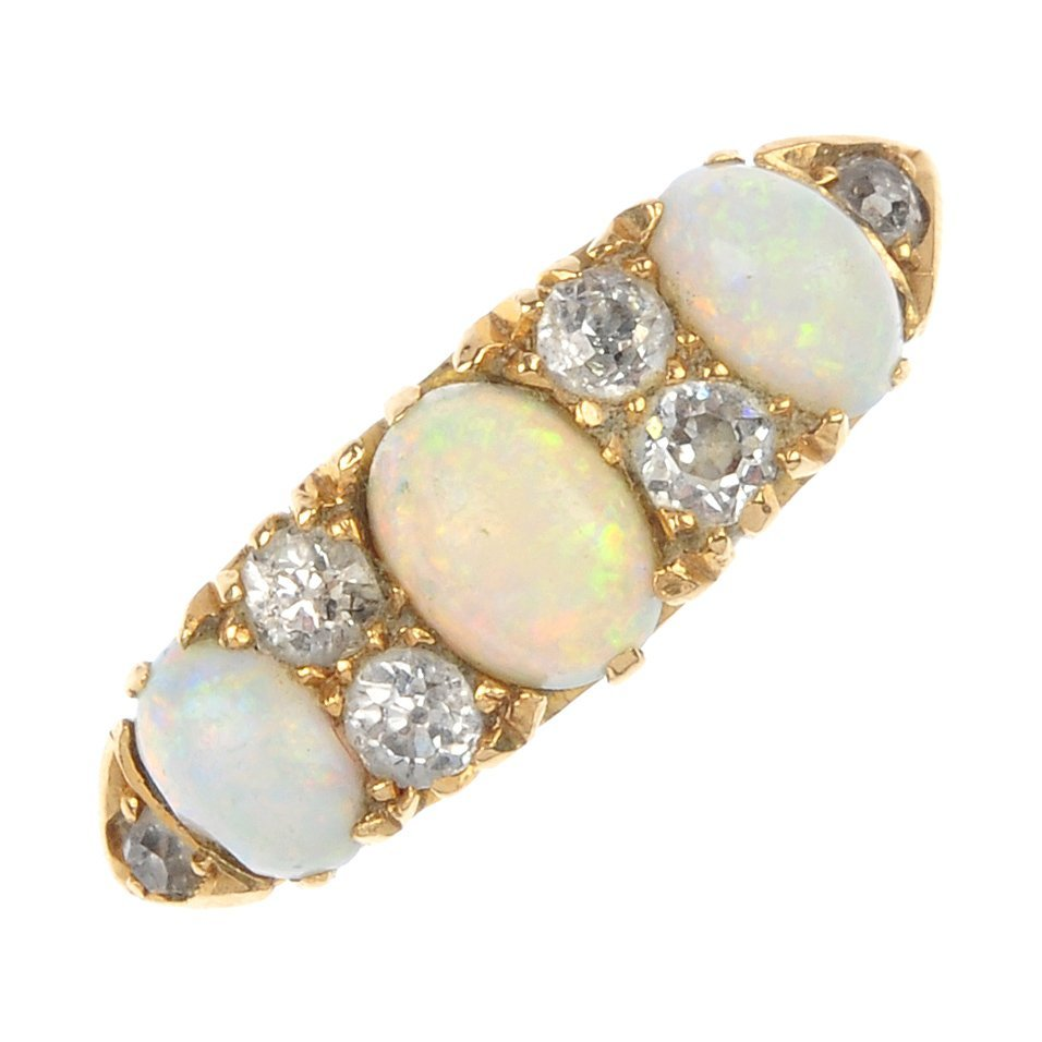 5: A late Victorian 18ct gold opal and diamond dress ri