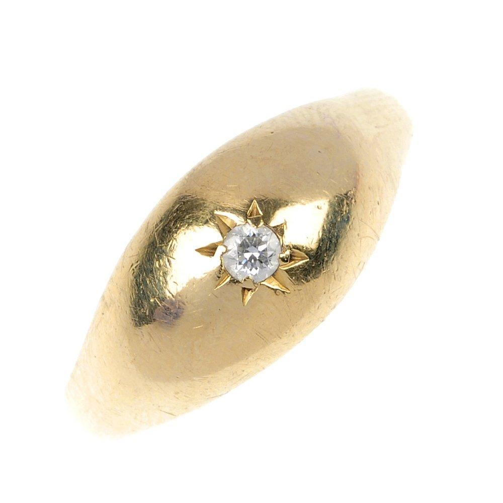 12: A gentleman's 9ct gold diamond single-stone ring.