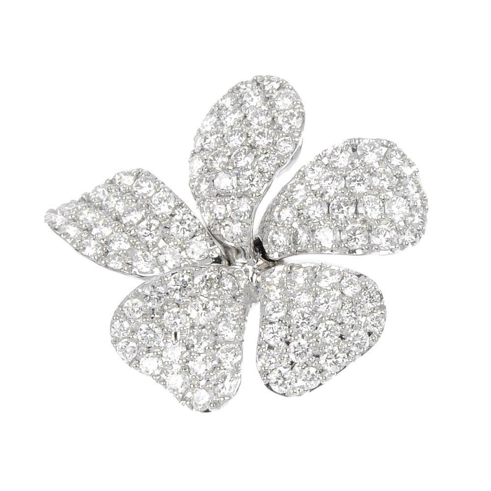 14: A diamond flower pendant.