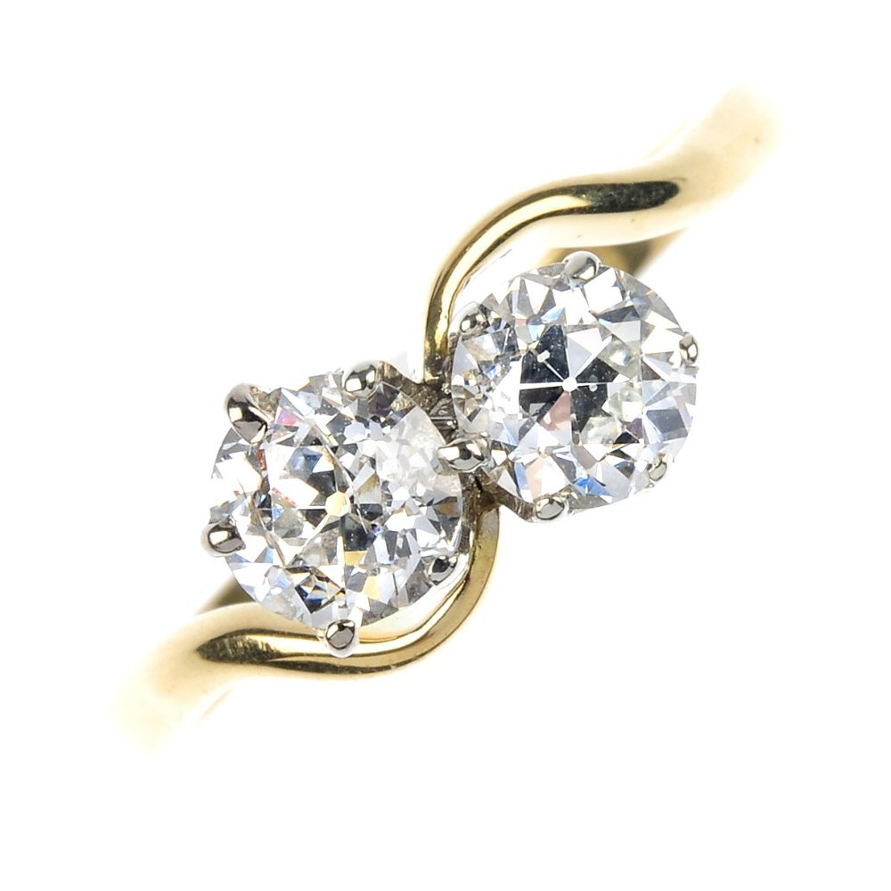 15: An 18ct gold diamond two-stone ring.