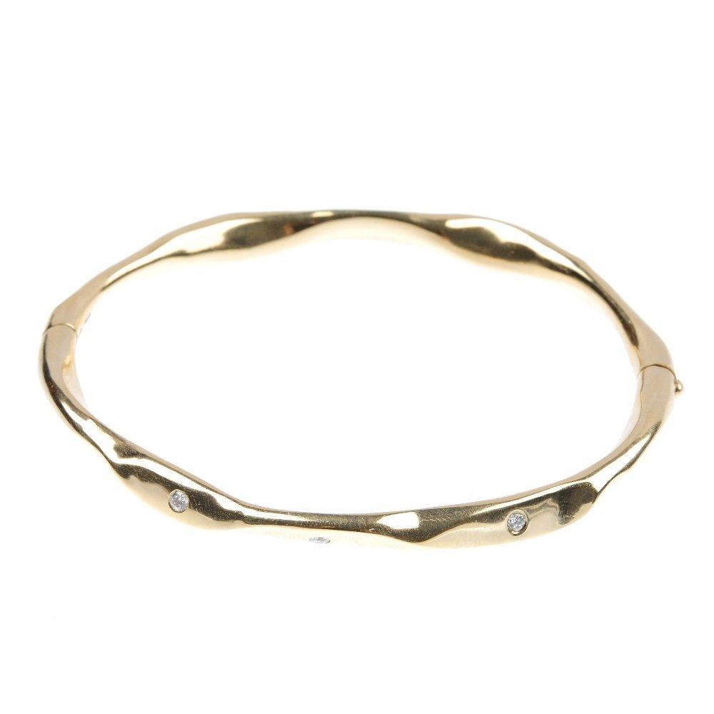 17: A 9ct gold diamond bangle.