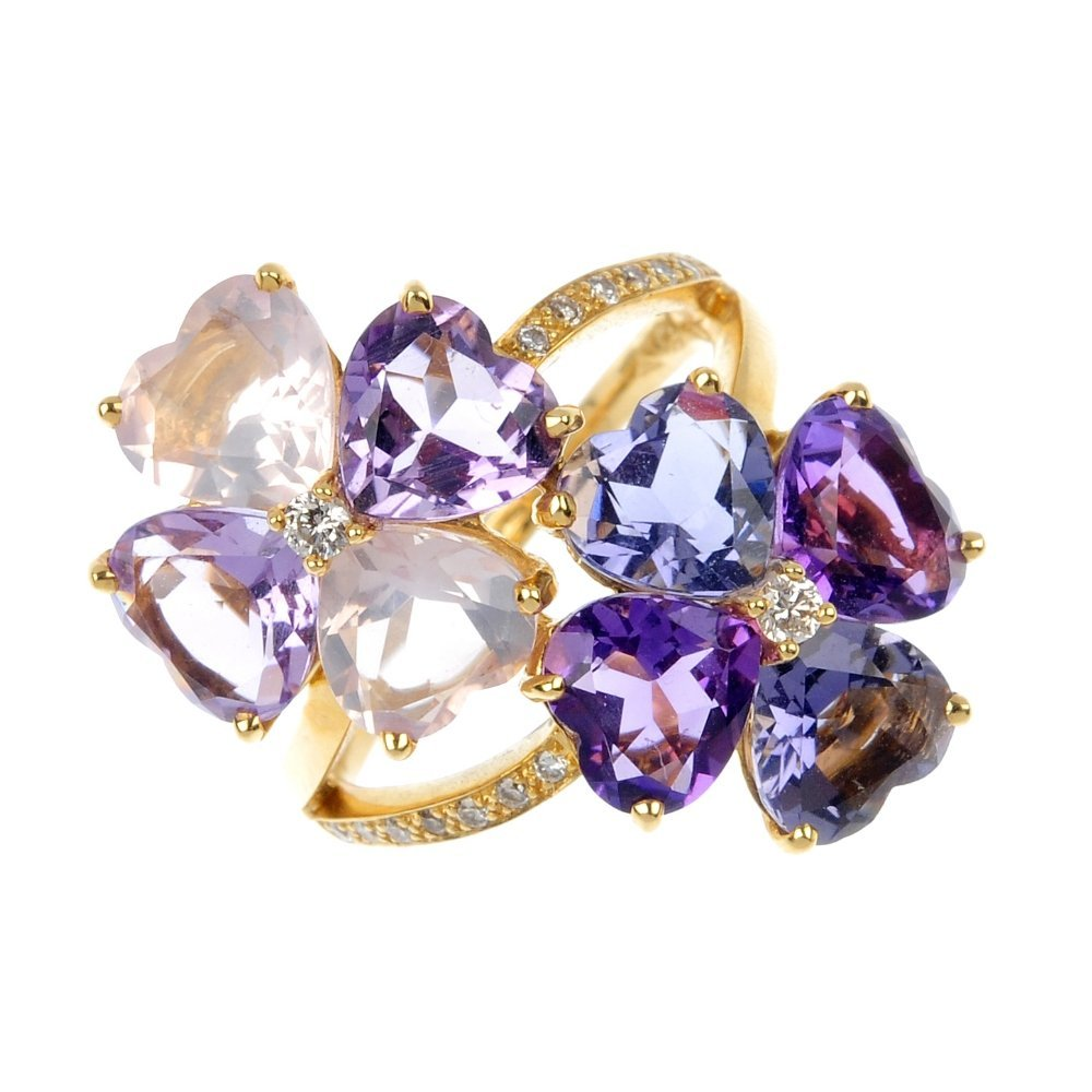 19: An 18ct gold multi-gem and diamond floral ring.