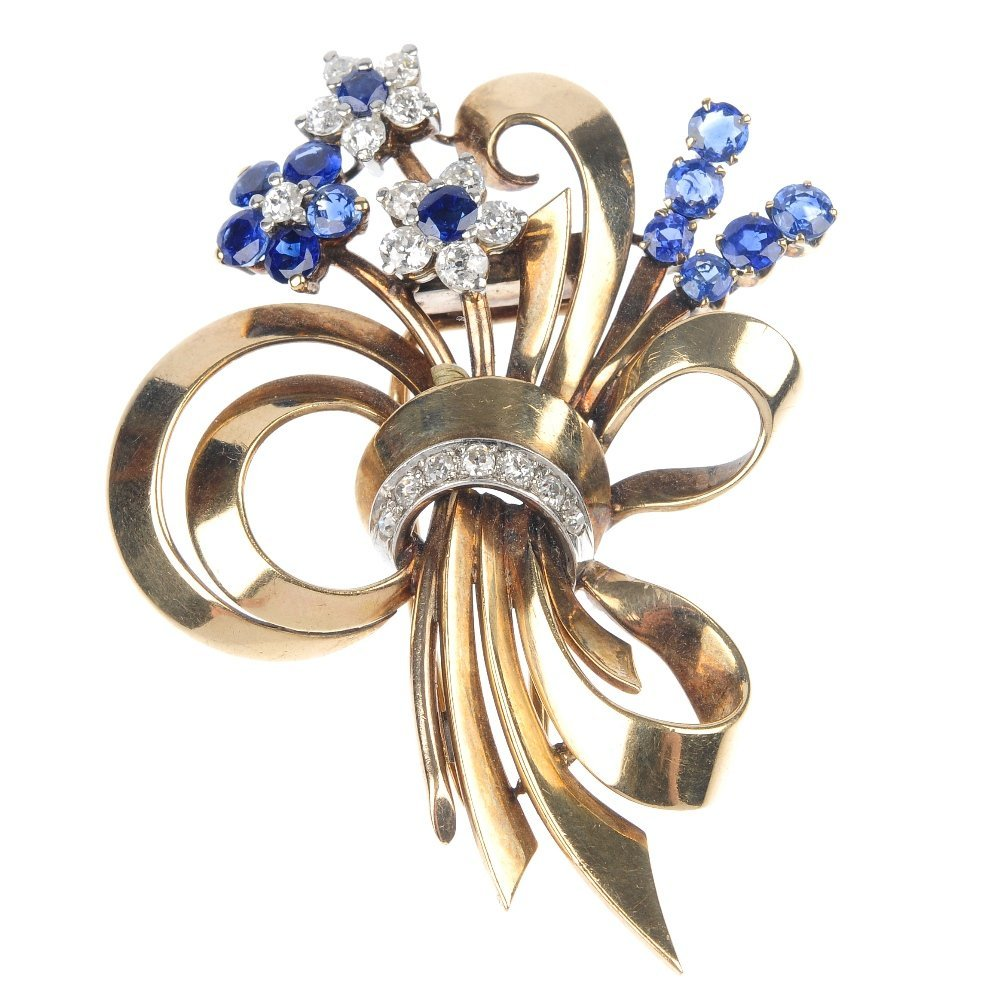 20: A mid 20th century gold diamond and sapphire floral