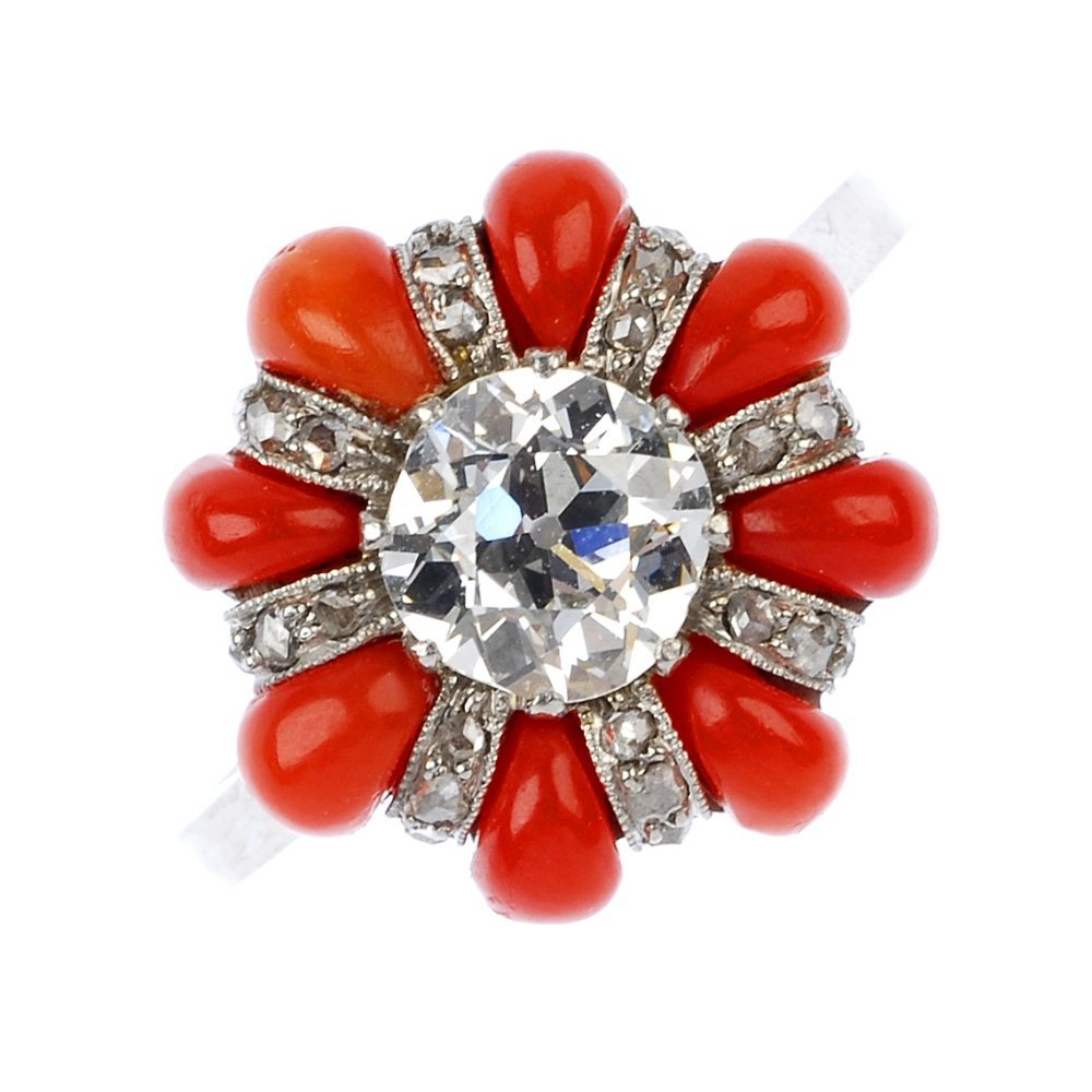 22: An early 20th century platinum diamond and coral cl