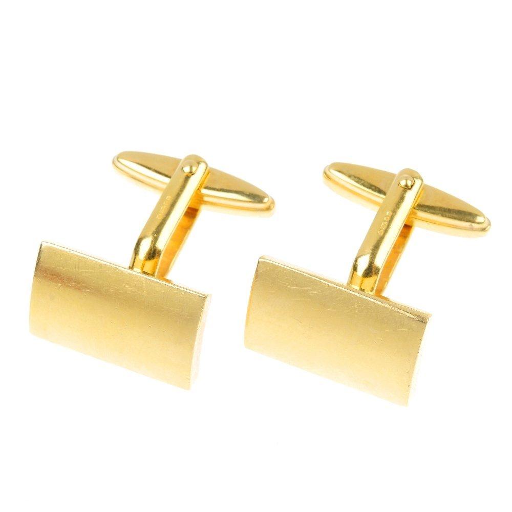 23: A pair of 18ct gold cufflinks.