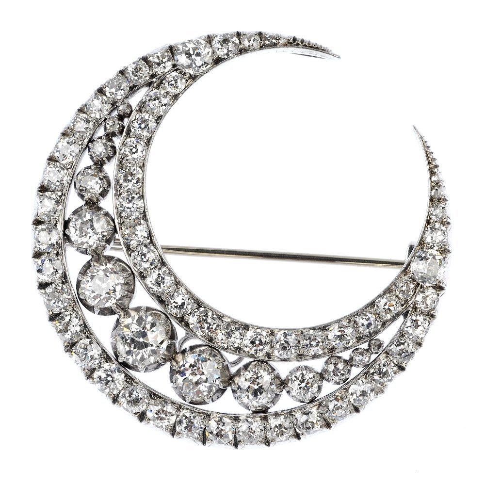 355: An early 20th century diamond crescent brooch.