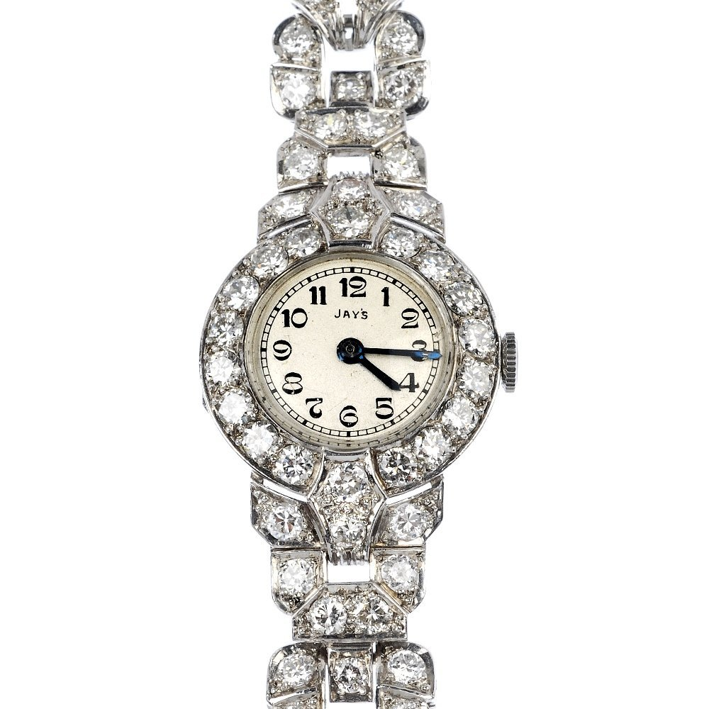 586: A mid 20th century platinum diamond cocktail watch