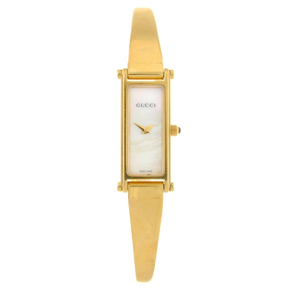 17: A gold plated quartz lady's Gucci bangle watch.