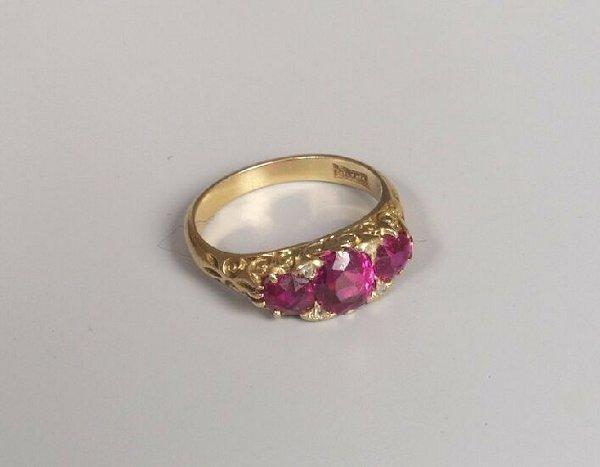9: Late Edwardian 18ct gold three stone ruby