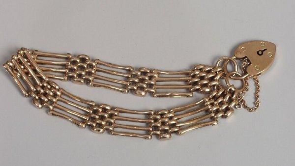 17: 9ct gold plain four bar gate link bracele