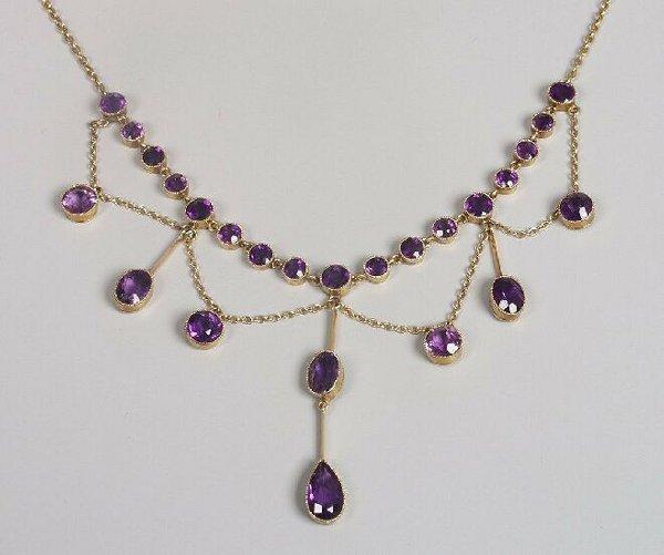 21: Edwardian 15ct gold amethyst necklet, of
