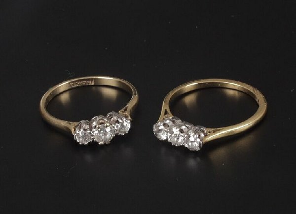 23: An 18ct gold and platinum claw set three
