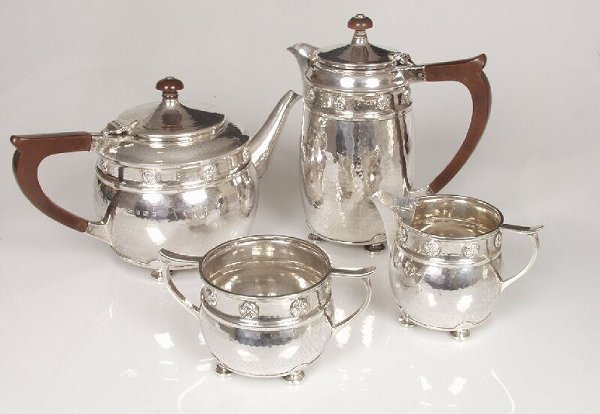 1021: A four piece silver tea service with sp