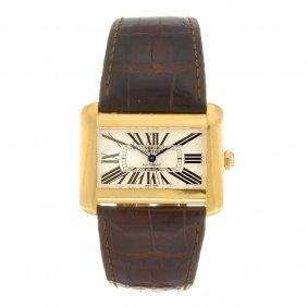 (134177147) An 18k gold automatic Cartier Divan wrist w
