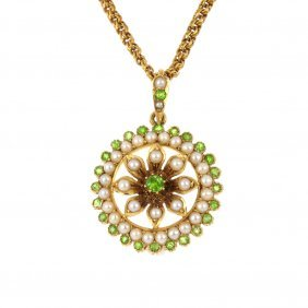 An early 20th century 15ct gold demantoid garnet and sp