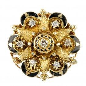 A diamond and enamel brooch.