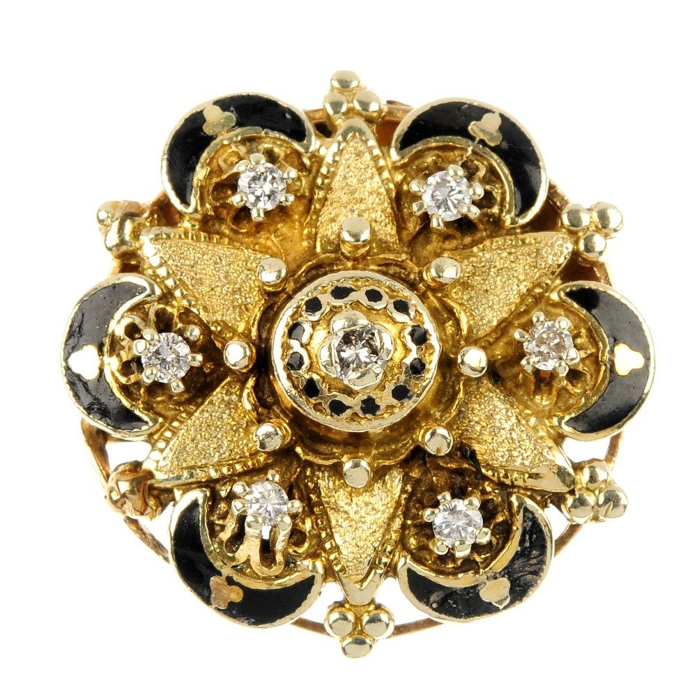 A diamond and enamel brooch.