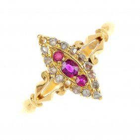 An Edwardian 18ct gold ruby and diamond cluster ring.